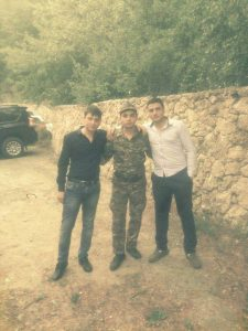 Hayk Hakobyan being visited by his friends while in the army