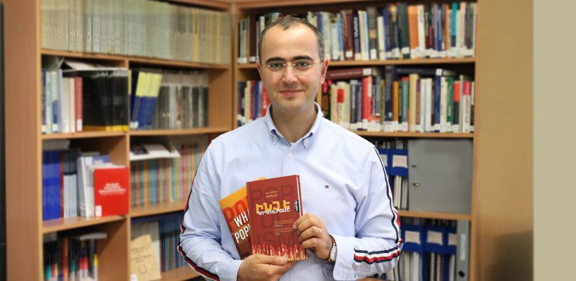 Hovhannes Nikoghosyan with his translation of 'What is Populism?'
