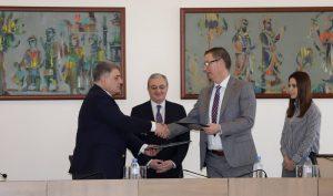 Vahagn Melikyan, MFA general secretary, shaking hand with CHSS Dean Brian Ellison