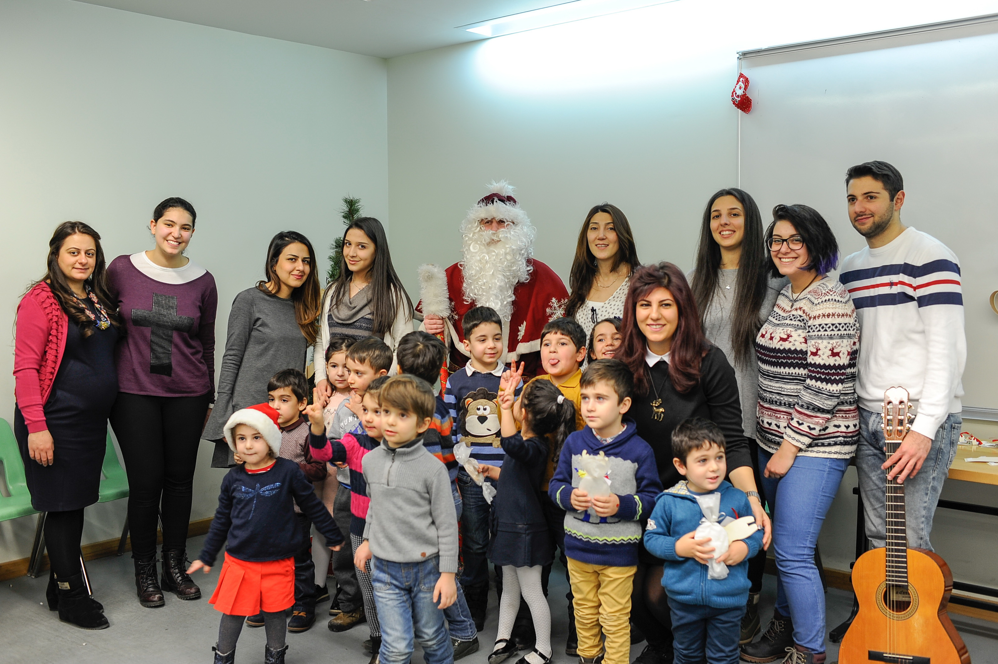 AUA's Preschool Program Delivers Christmas Presents to Children in Oncology Hospitals